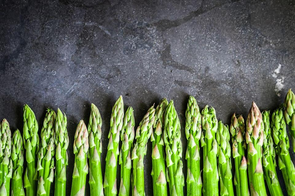 """<p>Whether you enjoy <a href=""""https://www.goodhousekeeping.com/food-recipes/cooking/g19746678/how-to-cook-asparagus/"""" rel=""""nofollow noopener"""" target=""""_blank"""" data-ylk=""""slk:asparagus"""" class=""""link rapid-noclick-resp"""">asparagus</a> roasted or sauteed, grab a bunch the next time you're at the grocery store. The stalks contain only a few calories but lots of fiber and micronutrients such as folate, vitamin C, vitamin A, and vitamin K. </p>"""