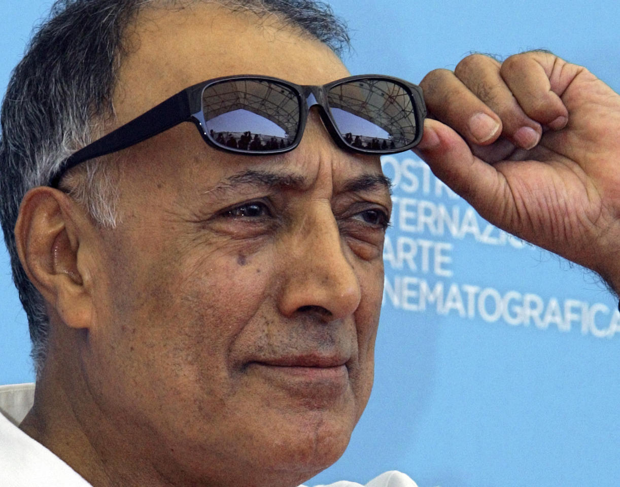 """FILE - In an Aug. 28, 2008 file photo, acclaimed Iranian film director Abbas Kiarostami poses during the photo call of his movie 'Shirin' (My sweet Shirin) at the 65th edition of the Venice Film Festival in Venice, Italy. Iran's official news agency IRNA says Kiarostami, whose 1997 film """"Taste of Cherry"""" won the Palme d'Or, died Monday, July 4, 2016, in Paris, where he had gone for cancer treatment. He was 76. (AP Photo/Domenico Stinellis, File)"""