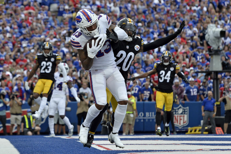 Buffalo Bills wide receiver Gabriel Davis (13) catches a pass in the endzone for a touchdown from quarterback Josh Allen, with Pittsburgh Steelers cornerback Cameron Sutton (20) defending, during the first half of an NFL football game in Orchard Park, N.Y., Sunday, Sept. 12, 2021. (AP Photo/Adrian Kraus)