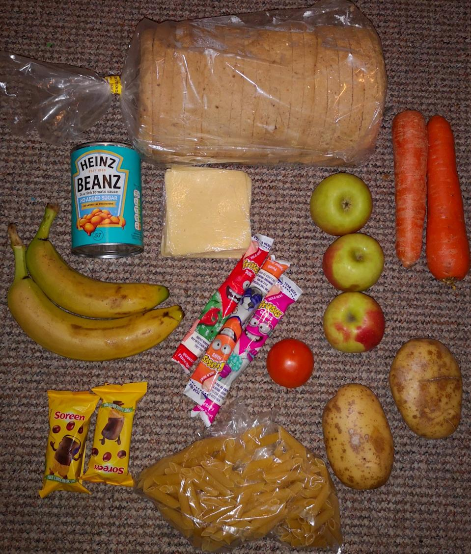 The contents of a parcel posted by @RoadsideMum on Twitter bag intended to last 10 days which was issued instead of £30 worth of food vouchers. (SWNS)