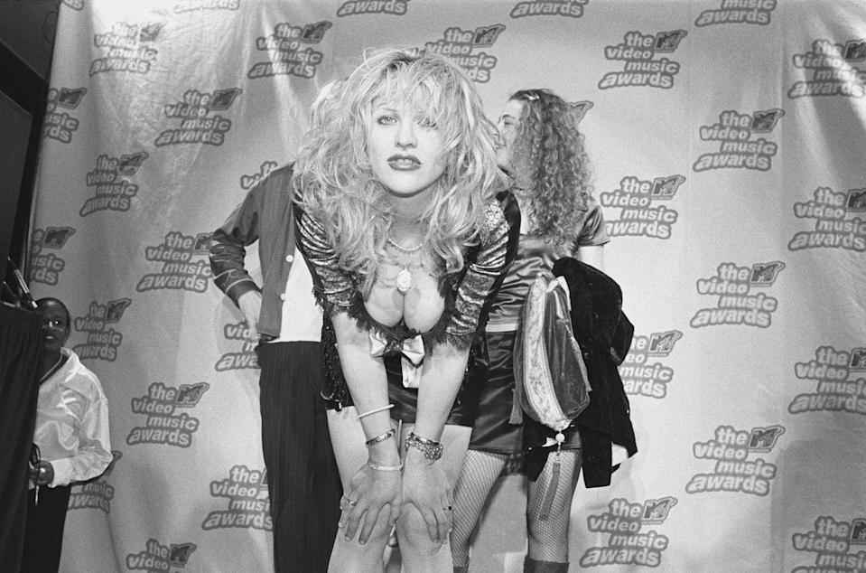<p>Courtney Love poses for a photo with her band Hole at the press podium backstage at the 12th annual MTV Awards on September 7, 1995 in New York City.</p>