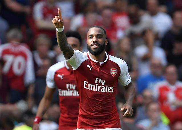 """Soccer Football - Premier League - Arsenal v West Ham United - Emirates Stadium, London, Britain - April 22, 2018 Arsenal's Alexandre Lacazette celebrates scoring their fourth goal REUTERS/Toby Melville EDITORIAL USE ONLY. No use with unauthorized audio, video, data, fixture lists, club/league logos or """"live"""" services. Online in-match use limited to 75 images, no video emulation. No use in betting, games or single club/league/player publications. Please contact your account representative for further details."""