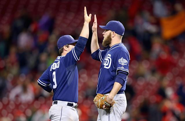 CINCINNATI, OH - MAY 15: Jedd Gyorko #9 and Kevin Quackenbush #59 of the San Diego Padres celebrate after the 9-1 victory in the second game of the doubleheader against the Cincinnati Reds at Great American Ball Park on May 15, 2014 in Cincinnati, Ohio. (Photo by Andy Lyons/Getty Images)