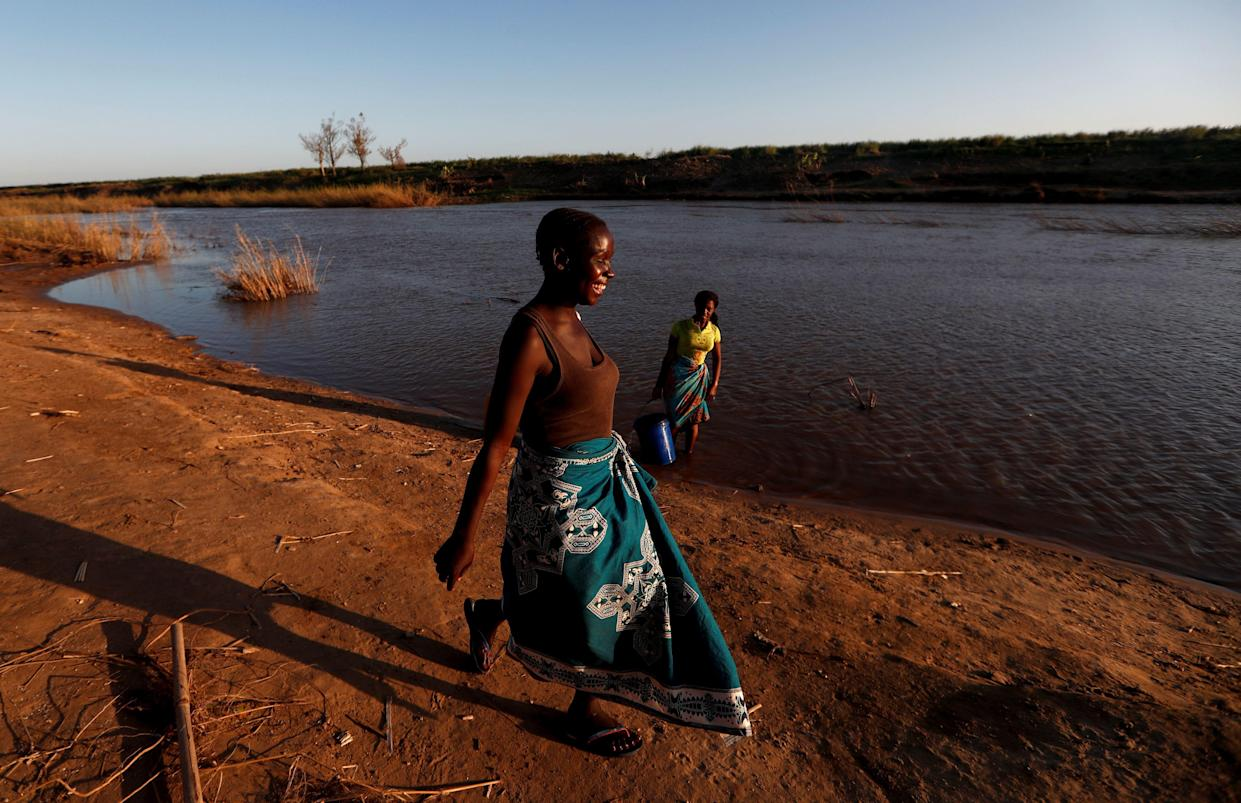 Jofresse walks at the edge of the Muda River to meet her father, who works on a water taxi. (Photo: Zohra Bensemra/Reuters)