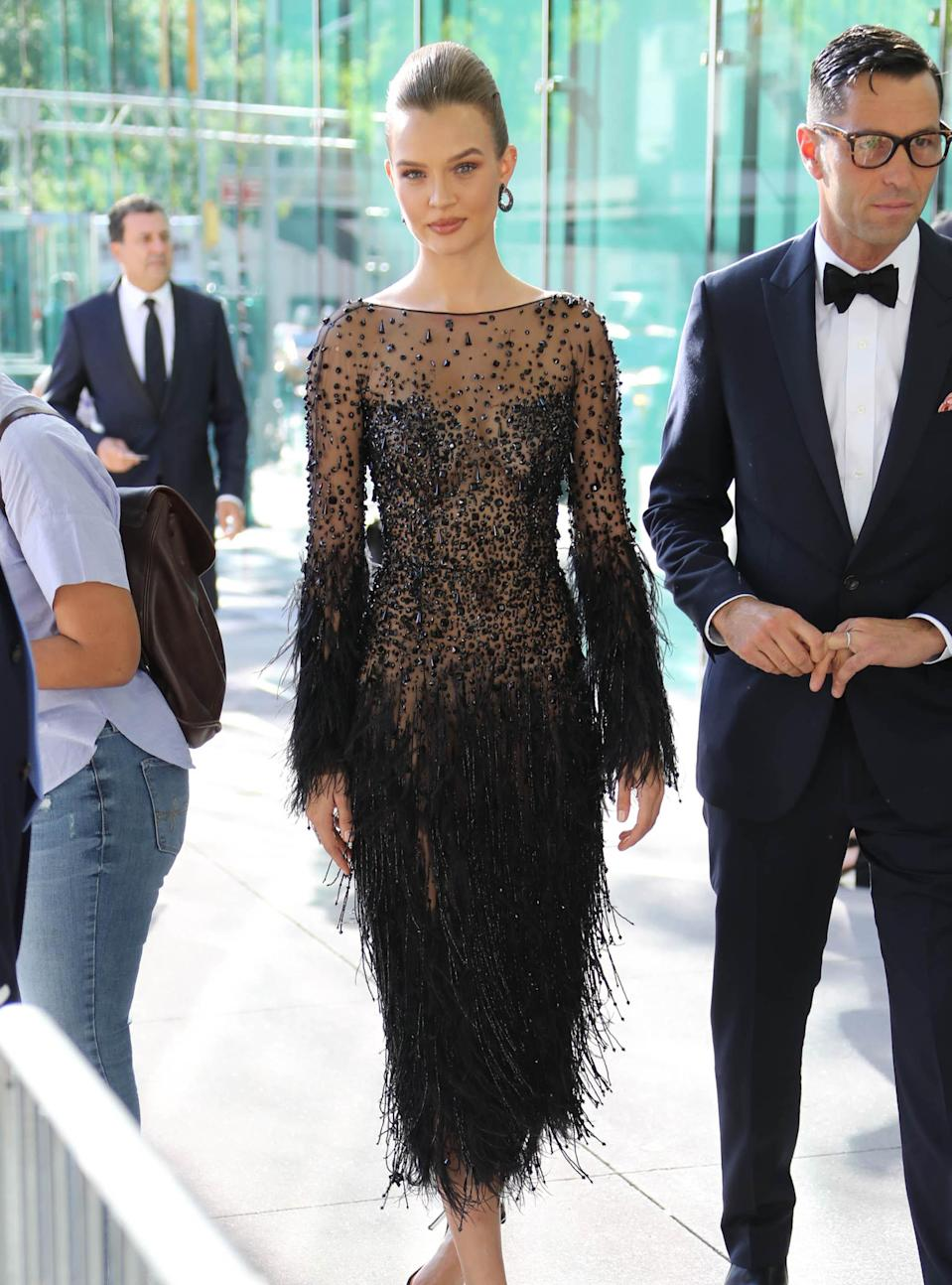 <p>Victoria's Secret model Josephine Skriver looked gorgeous in a sheer, feathered dress at the Fragrance Awards. <br><em>[Photo: Getty]</em> </p>