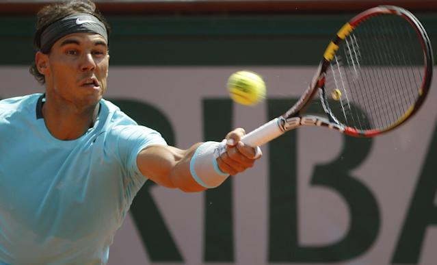 Spain's Rafael Nadal returns the ball during the final of the French Open tennis tournament against Serbia's Novak Djokovic at the Roland Garros stadium, in Paris, France, Sunday, June 8, 2014. (AP Photo/Michel Euler)