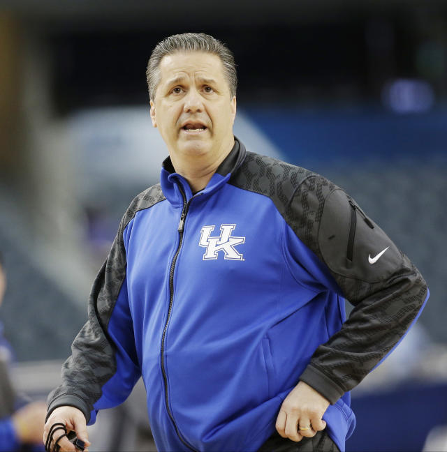 Kentucky head coach John Calipari runs a drill during practice for an NCAA Final Four tournament college basketball semifinal game Friday, April 4, 2014, in Dallas. Kentucky plays Wisconsin on Saturday, April 5, 2014. (AP Photo/David J. Phillip)