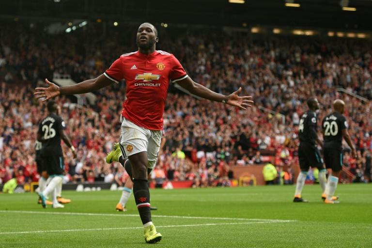 Manchester United's striker Romelu Lukaku celebrates scoring his team's second goal during the English Premier League football match against West Ham United August 13, 2017