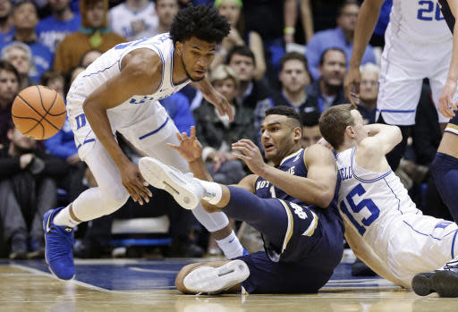 Duke's Marvin Bagley III, left, and Alex O'Connell (15) chase the ball with Notre Dame's Austin Torres during the first half of an NCAA college basketball game in Durham, N.C., Monday, Jan. 29, 2018. (AP Photo/Gerry Broome)