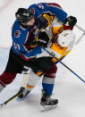 Colorado Avalanche left wing J.T. Compher (37) tangles with Nashville Predators defenseman Ryan Ellis (4) during the first period in Game 6 of an NHL hockey first-round playoff series Sunday, April 22, 2018, in Denver. (AP Photo/Jack Dempsey)