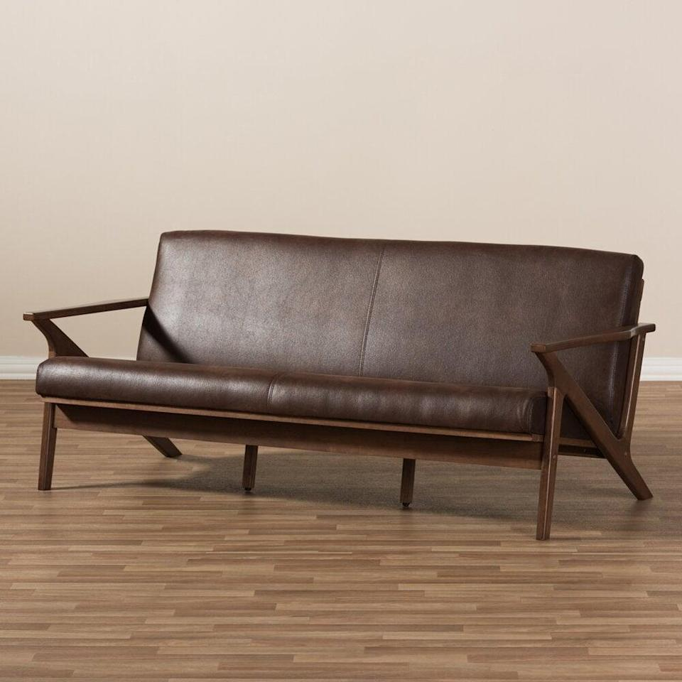 <p>This vintage-style <span>George Oliver Venice Faux Leather Recessed Arm Sofa</span> ($780, originally $954) offers stable comfort and durability with its sturdy frame and faux-leather seats.</p>