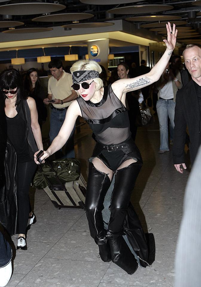 "Uh oh! Looks like those boots weren't meant for walking! Lady Gaga was literally a victim of fashion Wednesday when she took a tumble at London's Heathrow Airport. Well, the Lady never said her eccentric ensembles were practical! <a href=""http://www.infdaily.com"" target=""new"">INFDaily.com</a> - June 23, 2010"