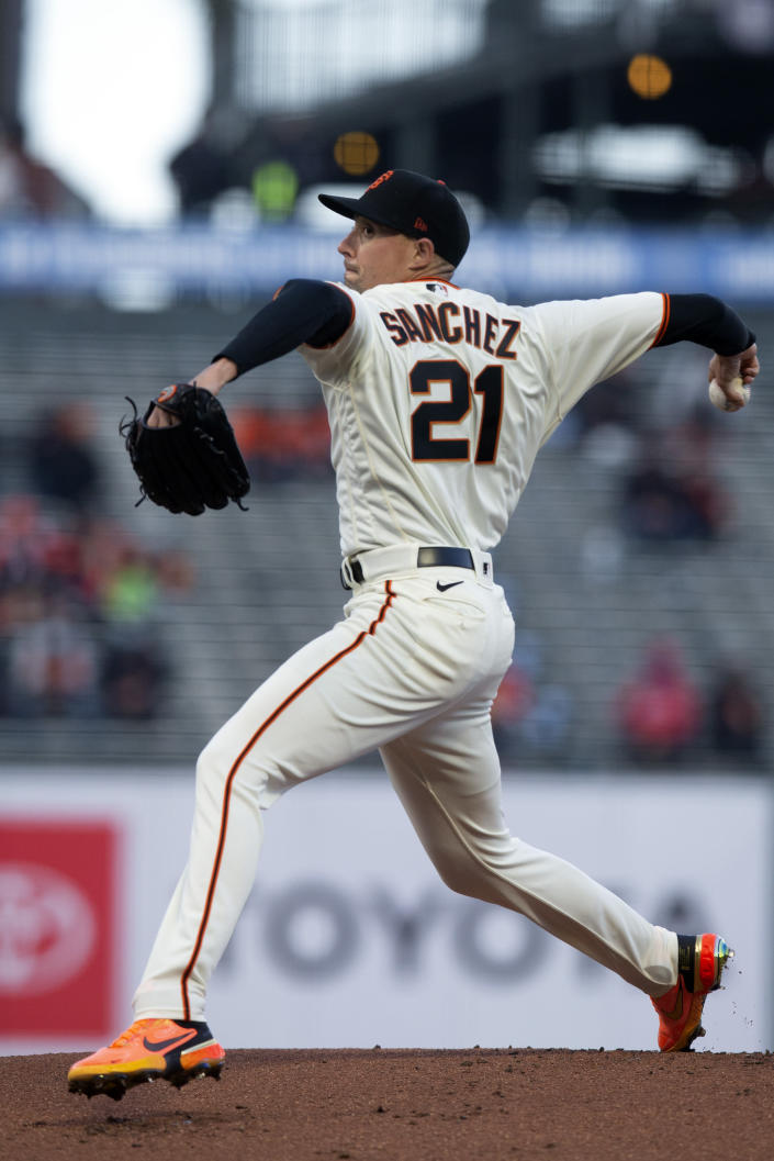 San Francisco Giants starting pitcher Aaron Sanchez (21) delivers a pitch against the Cincinnati Reds during the first inning of a baseball game, Monday, April 12, 2021, in San Francisco, Calif. (AP Photo/D. Ross Cameron)