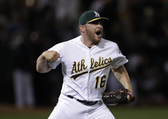 Oakland Athletics pitcher Liam Hendriks celebrates the final out of the team's baseball game against the New York Yankees on Wednesday, Aug. 21, 2019, in Oakland, Calif. The A's won 6-4. (AP Photo/Ben Margot)
