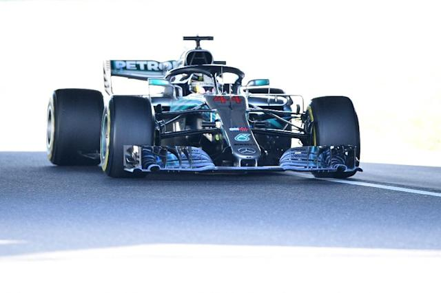 F1 fans can now experience the physical sensation of driving in Lewis Hamilton's car (AFP Photo/Martin BUREAU)