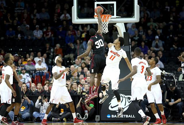 SPOKANE, WA - MARCH 20: Kyle Casey #30 of the Harvard Crimson dunks the ball over Jermaine Lawrence #11 and Titus Rubles #2 of the Cincinnati Bearcats during the second round of the 2014 NCAA Men's Basketball Tournament at Spokane Veterans Memorial Arena on March 20, 2014 in Spokane, Washington. (Photo by Stephen Dunn/Getty Images)
