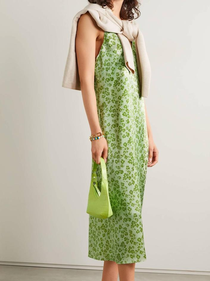 """How adorable is this floral-print <a href=""""https://www.glamour.com/gallery/best-slip-dresses?mbid=synd_yahoo_rss"""" rel=""""nofollow noopener"""" target=""""_blank"""" data-ylk=""""slk:slip dress"""" class=""""link rapid-noclick-resp"""">slip dress</a>? It's sleek, reasonably priced, and a great color for summer. Plus, you can easily dress it down and wear it again later on. $200, Net-a-Porter. <a href=""""https://www.net-a-porter.com/en-us/shop/product/reformation/clothing/mini-dresses/sofia-floral-print-silk-satin-midi-dress/10163292708410344"""" rel=""""nofollow noopener"""" target=""""_blank"""" data-ylk=""""slk:Get it now!"""" class=""""link rapid-noclick-resp"""">Get it now!</a>"""