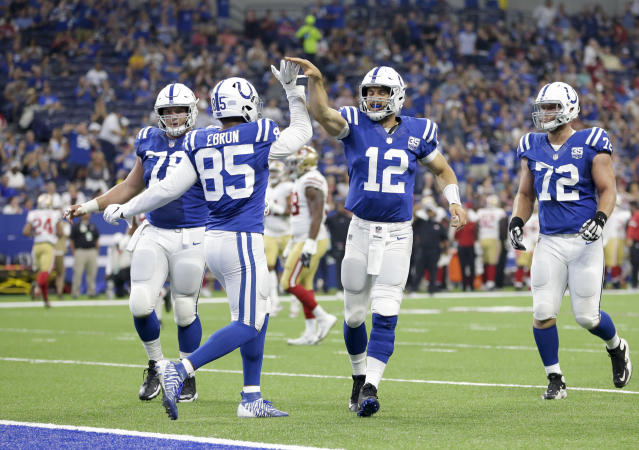 Indianapolis Colts tight end Eric Ebron (85) celebrates a touchdown reception with quarterback Andrew Luck (12) in the first half of an NFL preseason football game against the San Francisco 49ers in Indianapolis, Saturday, Aug. 25, 2018. (AP Photo/AJ Mast)