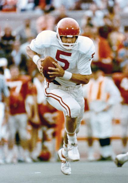 This undated photo provided by OU Athletics Communications shows quarterback Steve Davis playing football. A University of Oklahoma official says the starting quarterback for Oklahoma's national championship teams in 1974 and 1975 is one of two men killed when a small plane slammed into a house in northern Indiana on Sunday, March 17, 2013. St. Joseph County Coroner Randy Magdalinski identified the victims of Sunday's crash as 60-year-old Steven Davis and 58-year-old Wesley Caves, both of Tulsa, Okla. (AP Photo/OU Athletics Communications)