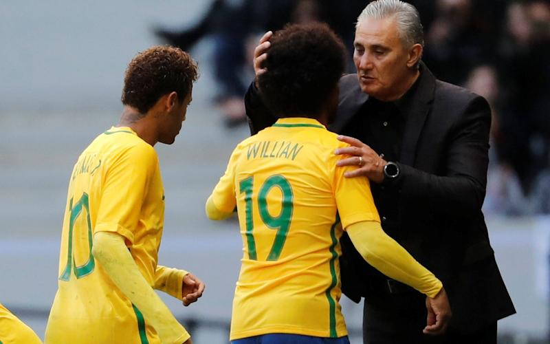 Tite congratulates Neymar and Willian when he takes them off during the victory over Japan in Lille - REUTERS
