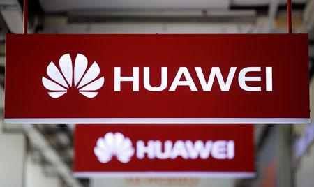 Huawei signage are pictured at a mobile phone shop in Singapore