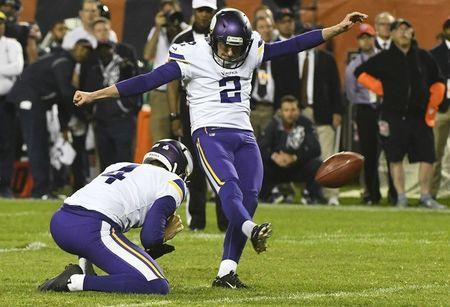Oct 9, 2017; Chicago, IL, USA; Minnesota Vikings kicker Kai Forbath (2) kicks the game winning field goal against the Chicago Bears as Vikings punter Ryan Quigley (4) holds in the second half at Soldier Field. Mandatory Credit: Matt Marton-USA TODAY Sports