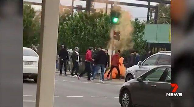 Someone lets off a flare on the street. Source: 7 News