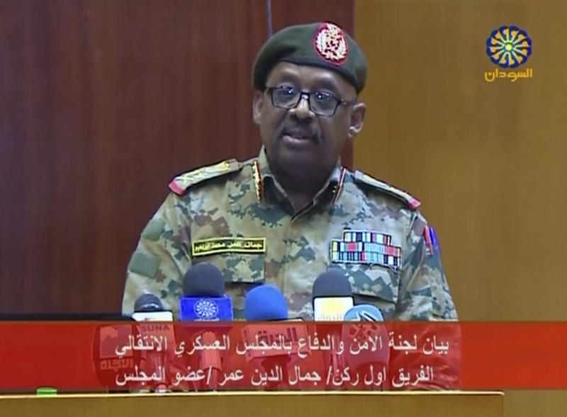"In this Sunday, June 9, 2019 frame grab from SUDAN TV, Lt. Gen. Jamaleddine Omar, from the ruling military council, speaks on a broadcast of SUDAN TV. Sudan's ruling military is blaming the leaders of the country's protest movement for an escalation as the second day of the opposition's general strike kicks in. The protesters have been trying to pressure the army to hand over power to civilian rule following the April ouster of longtime autocrat Omar al-Bashir. Arabic banner reads: ""The statement of Security and Defense Committee of the Transitional Military Council