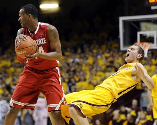 Minnesota's Oto Osenieks (10) falls while defending Ohio State's William Buford (44) in the second half during an NCAA college basketball game in Minneapolis on Tuesday, Feb. 14, 2012. (AP Photo/Hannah Foslien)