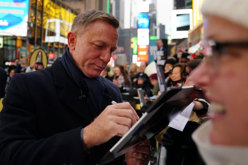 """Actor Daniel Craig signs autographs during a promotional appearance on TV in Times Square for the new James Bond movie """"No Time to Die"""" in the Manhattan borough of New York City"""