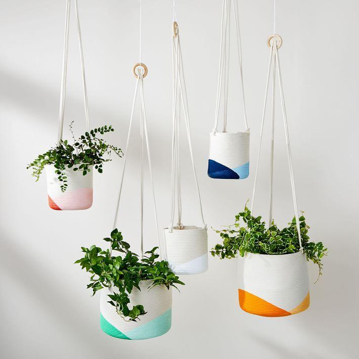 """<h2>Closed Mondays Hanging Planter</h2> <br>Crafted from cotton rope and accented with handpainted design, these coiled hanging planters will add a vibrant elevated statement inside any space. <br><br><strong>Closed Mondays</strong> Hanging Planter, Small, Blue, $, available at <a href=""""https://www.westelm.com/products/lcl-closed-mondays-hanging-planters-d6432/"""" rel=""""nofollow noopener"""" target=""""_blank"""" data-ylk=""""slk:West Elm"""" class=""""link rapid-noclick-resp"""">West Elm</a><br>"""