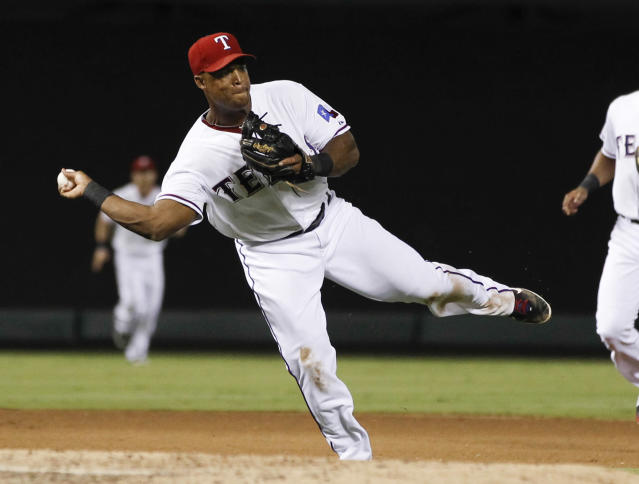 Texas Rangers third baseman Adrian Beltre throws to first for the out on a grounder by Houston Astros' Marwin Gonzalez during the seventh inning of a baseball game, Wednesday, Aug. 21, 2013, in Arlington, Texas. (AP Photo/Jim Cowsert)