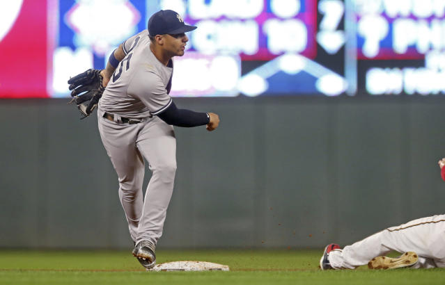 New York Yankees second baseman Gleyber Torres, left, watches his successful throw to complete the double play after the force at second base of Minnesota Twins' Robbie Grossman in the fourth inning of a baseball game Monday, Sept. 10, 2018, in Minneapolis. (AP Photo/Jim Mone)