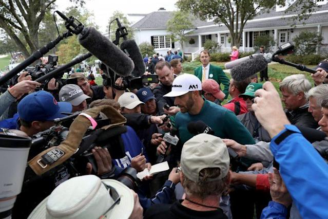 Dustin Johnson talks to the media after withdrawing from the Masters. (AP)