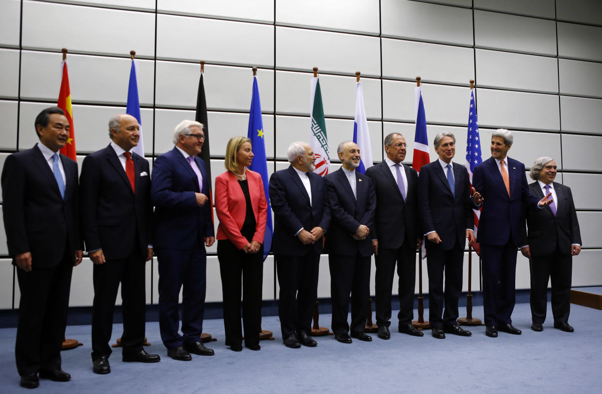 """From left: Chinese Foreign Minister Wang Yi, French Foreign Minister Laurent Fabius, German Foreign Minister Frank-Walter Steinmeier, <span>High Representative of the Union for Foreign Affairs and Security Policy</span> Federica Mogherini, Iranian Foreign Minister Mohammad Javad Zarif, Head of the Iranian Atomic Energy Organization Ali Akbar Salehi, Russian Foreign Minister Sergey Lavrov, British Foreign Secretary Philip Hammond, U.S. Secretary of State John Kerry and U.S. Secretary of Energy Ernest Moniz pose for a group picture at the United Nations building in Vienna, July 14, 2015. Iran and six major world powers reached a nuclear deal, capping more than a decade of on-off negotiations with an agreement that could potentially transform the Middle East and which Israel called an """"historic surrender."""" (Photo: Leonhard Foeger/Reuters)"""