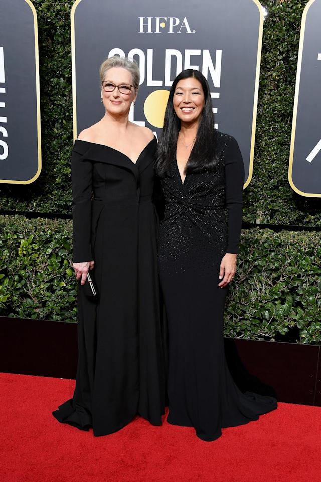 Actor Meryl Streep (L) and activist Ai-jen Poo attend The 75th Annual Golden Globe Awards at The Beverly Hilton Hotel on January 7, 2018 in Beverly Hills, California. (Photo by Steve Granitz/WireImage)