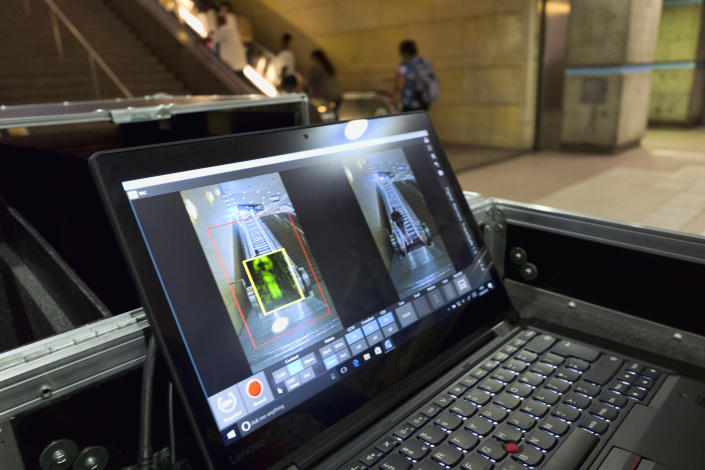 ThruVision suicide vest-detection technology that reveals suspicious objects on people is seen during a Transportation Security Administration demonstration at Union Station in Los Angeles on Tuesday, Aug. 14, 2018. Los Angeles is poised to have the first mass transit system in the U.S. with body scanners that screen passengers for weapons and explosives. (AP Photo/Richard Vogel)