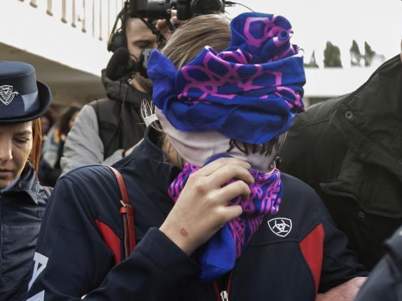 The 19-year-old's face was covered to protect her identity (AFP/Getty)