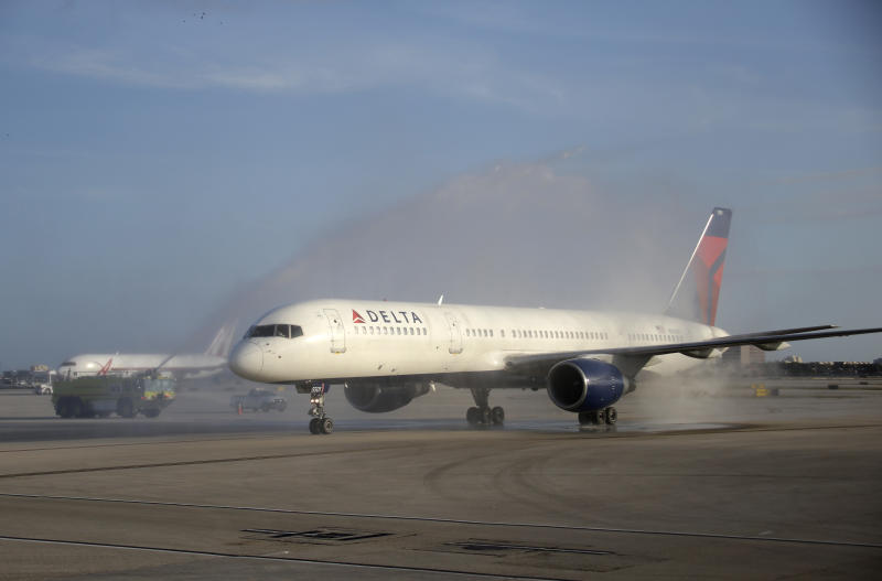 An airplane carrying the Alabama team is sprayed with a water cannon after arriving at Miami International Airport, Wednesday, Jan. 2, 2013 in Miami.  Alabama takes on Notre Dame in the BCS national championship NCAA college football game next Monday in Miami. (AP Photo/Wilfredo Lee)