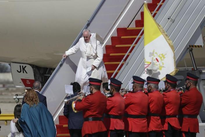 Pope Francis arrives at Baghdad's international airport, Iraq, Friday, March 5, 2021. Pope Francis heads to Iraq on Friday to urge the country's dwindling number of Christians to stay put and help rebuild the country after years of war and persecution, brushing aside the coronavirus pandemic and security concerns. (AP Photo/Andrew Medichini)