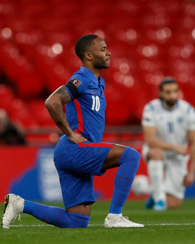 Raheem Sterling kneels against racism before England kick off a World Cup qualifier. Debate over the gesture has loomed large in the culture wars.