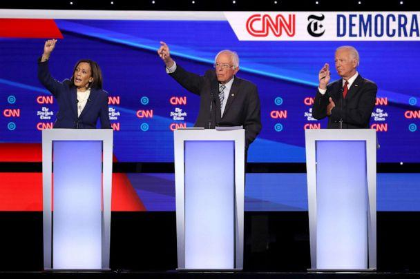 PHOTO: Sen. Kamala Harris (D-CA), Sen. Bernie Sanders (I-VT) and former Vice President Joe Biden raise their hands during the Democratic Presidential Debate at Otterbein University on October 15, 2019 in Westerville, Ohio. (Win Mcnamee/Getty Images)