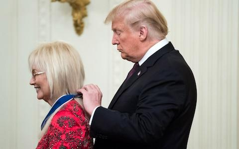 President Donald Trump awards the Medal of Freedom to Miriam Adelson, a doctor and philanthropist who is married to businessman and Republican megadonor Sheldon Adelson - Credit:  UPI / Barcroft Images