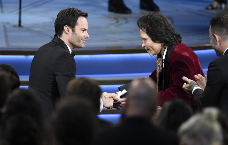 """Teddy Perkins, right, congratulates Bill Hader as he gets ready to walk on stage to accept the award for outstanding lead actor in a comedy series for """"Barry"""" at the 70th Primetime Emmy Awards on Monday, Sept. 17, 2018, at the Microsoft Theater in Los Angeles. (Photo by Chris Pizzello/Invision/AP)"""