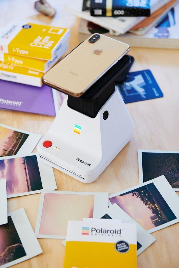 """<h3><a href=""""https://www.urbanoutfitters.com/shop/polaroid-originals-photo-printer-lab?category=SEARCHRESULTS&color=010"""" rel=""""nofollow noopener"""" target=""""_blank"""" data-ylk=""""slk:Polaroid Photo Printer Lab"""" class=""""link rapid-noclick-resp"""">Polaroid Photo Printer Lab</a></h3><br>Giftees can transform their Instagrams into polaroids with the press of a button, thanks to this compact-printing gadget with throwback flair. <br><br><strong>Polaroid</strong> Originals Photo Printer Lab, $, available at <a href=""""https://www.urbanoutfitters.com/shop/polaroid-originals-photo-printer-lab"""" rel=""""nofollow noopener"""" target=""""_blank"""" data-ylk=""""slk:Urban Outfitters"""" class=""""link rapid-noclick-resp"""">Urban Outfitters</a>"""