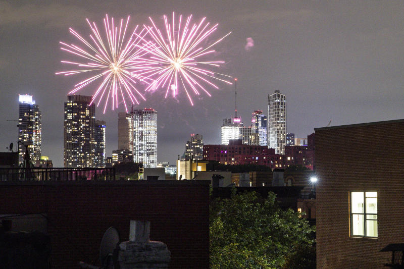 FILE - In this Friday, June 19, 2020 photo, fireworks explode during Juneteenth celebrations above the Bedford-Stuyvesant neighborhood in the Brooklyn borough of New York. The Manhattan skyline is seen in the background. They light up the sky in celebration, best known in the U.S. as a way to highlight Independence Day. This year, fireworks aren't being saved for special events. They've become a nightly nuisance from Connecticut to California, angering sleep-deprived citizens and alarming local officials. (AP Photo/John Minchillo, File)