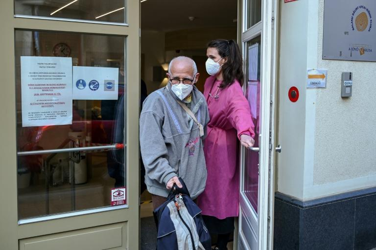 A pensioner leaves a seniors club in Budapest where he had received his first dose of the Covid-19 vaccine developed by China's Sinopharm company