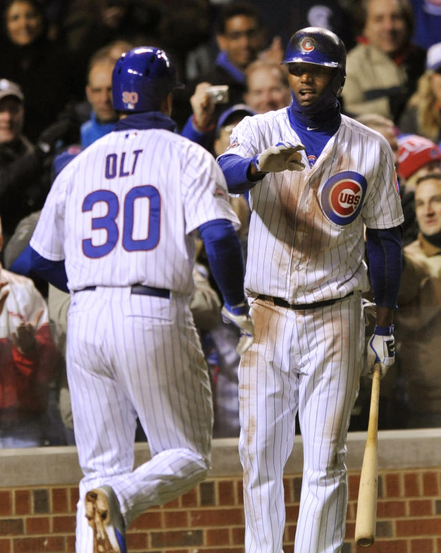 Chicago Cubs' Junior Lake right, celebrates with teammate Mike Olt (30), after Olt hit a three-run home run during the fifth inning of a baseball game against the Arizona Diamondbacks in Chicago, Tuesday, April 22, 2014. (AP Photo/Paul Beaty)