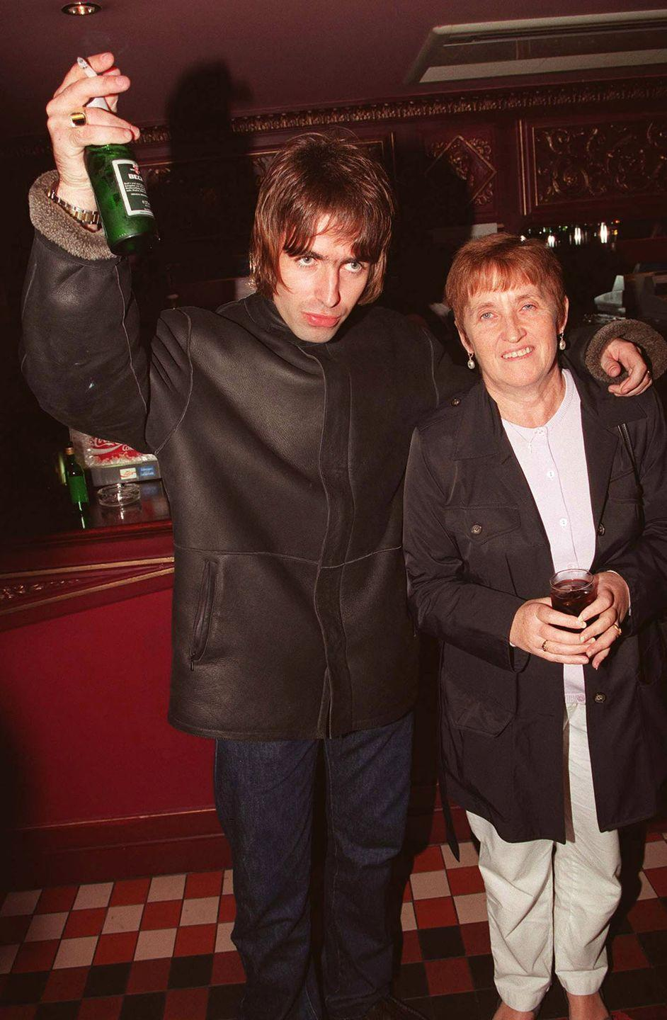 <p>Liam with is mother Peggy at the opening night of Steve Coogan's comedy show in the West End, London in 1995.</p>