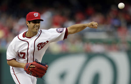 FILE PHOTO: Washington Nationals starting pitcher Gio Gonzalez throws against the Atlanta Braves in the first inning of their MLB National League baseball game in Washington August 6, 2013. REUTERS/Gary Cameron